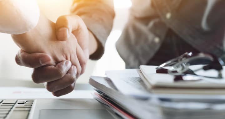 personal injury lawyer shaking hands with a client